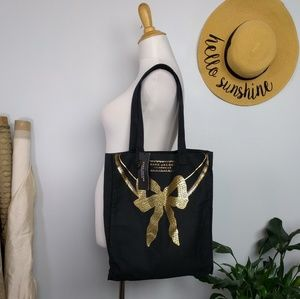 Marc Jacobs Tote Bag Gold Bow New. Black canvas to